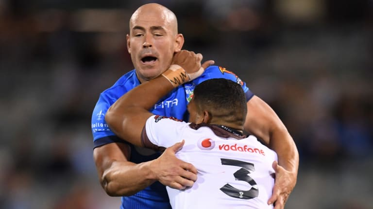 Terry Campese tackles Taane Milne of Fiji.