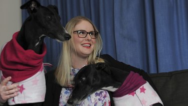 Alana Wade of Flynn at her home, with her two adopted greyhounds, Tiffany, left and Sugar.