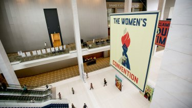 Attendees arrive as signage is displayed during the Women's Convention in Detroit, Michigan.