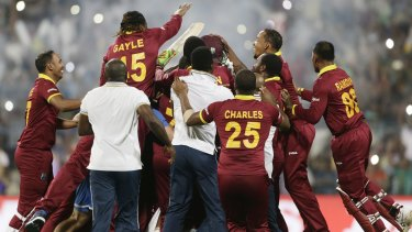 West Indies players celebrate after defeating England in the final of the ICC World Twenty20 tournament at Eden Gardens in Kolkata on Sunday.