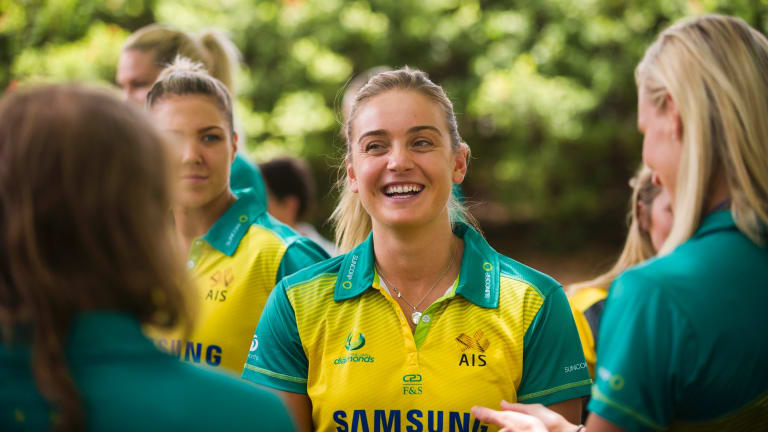 Diamonds youngster Liz Watson enjoys a laugh with teammates in Canberra on Thursday.