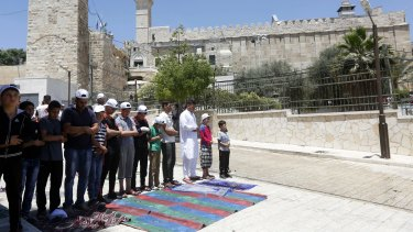 Palestinians attend Friday prayers at the Ibrahimi Mosque during the holy month of Ramadan.