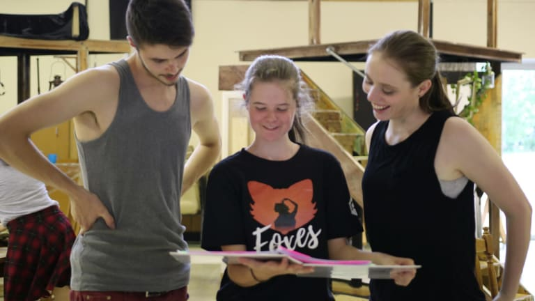 Foxes director Rachel Pengilly, centre, shares notes with actors Tanner Clark, left and Katherine Berry on the set.