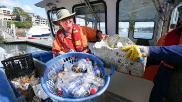 Clean Up Australia Day volunteers battle the bottle scourge in Sydney's waterways in March this year.