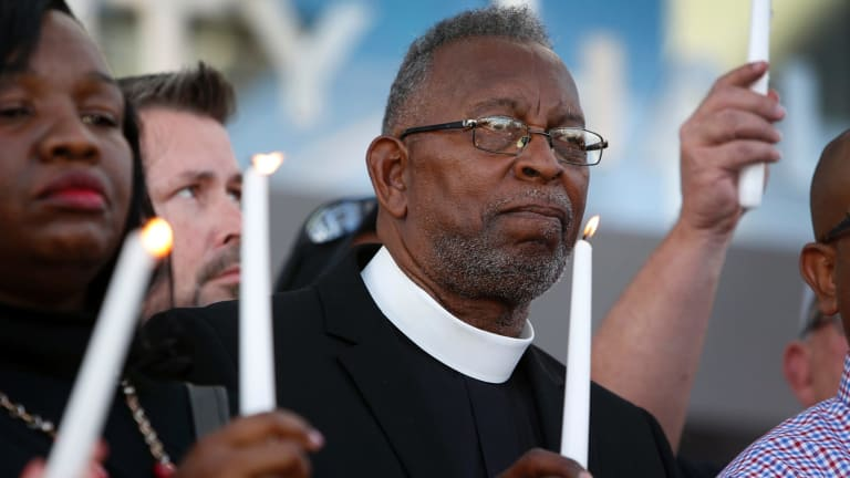 Pastor William McCurdy holds a candle during a prayer vigil in honour of those affected by the shooting on the Las Vegas Strip.