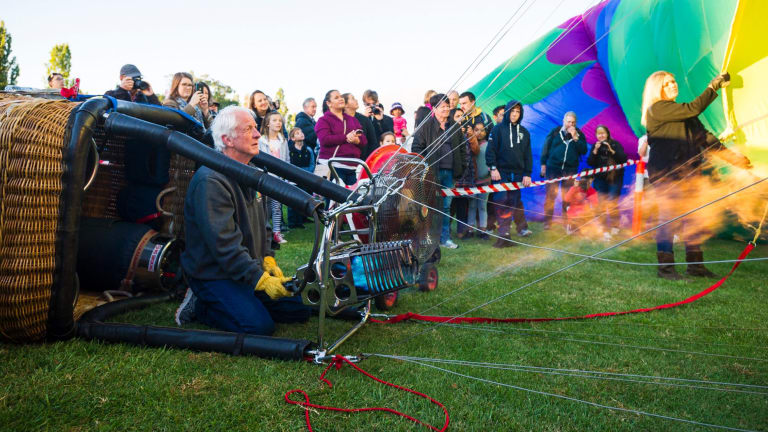 Canberra Balloon Festival 2018. Hot air balloon pilot Doug Grimes prepares the hummingbird hot air balloon for lift off.