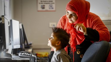 Toorpaikai Baees with her son Arash during a program where Muslim mothers are taught IT skills so they can better understand what kids are looking at online – especially the risk of extremist propaganda.