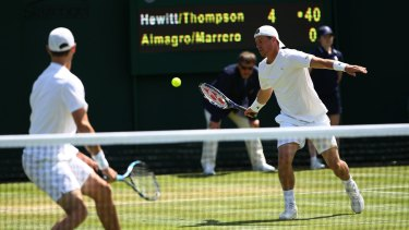 Evergreen: Lleyton Hewitt plays a forehand with Jordan Thompson during the men's doubles first round match against Nicolas Almegaro and David Maarrero.