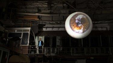 Artist Yukinori Yanagi is dwarfed by his installation Landscape With An Eye.