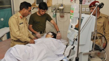 Army doctors treat Malala after she was shot in 2012.