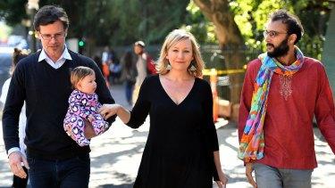 Cr Jonathan Sri accompanies Larissa Waters, her partner Jeremy Gates and daughter Alia Joy, to announce her resignation as a Greens senator.