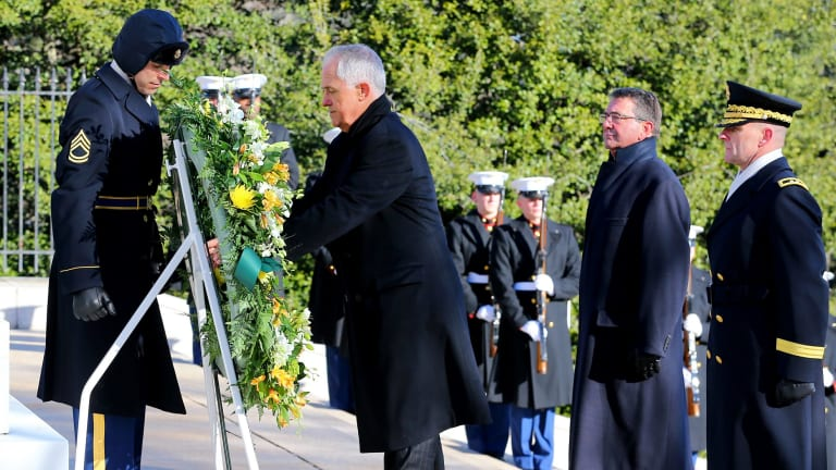 Mr Turnbull lays a wreath at the tomb of the Unknowns at Arlington War Cemetery in Virginia.