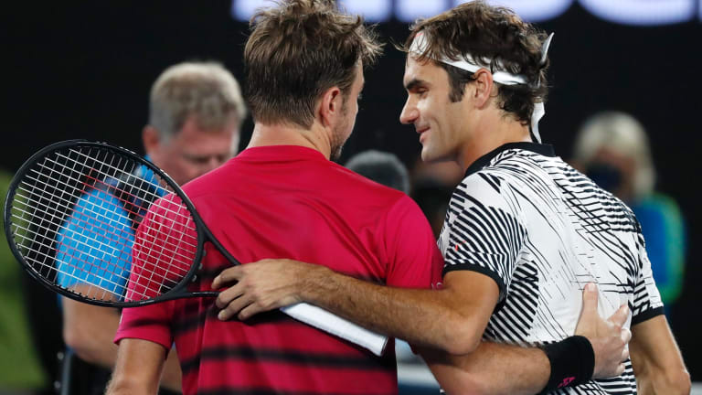 Federer is congratulated by Wawrinka.
