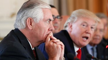 On the same page? US Secretary of State Rex Tillerson, left, in a meeting with President Donald Trump.