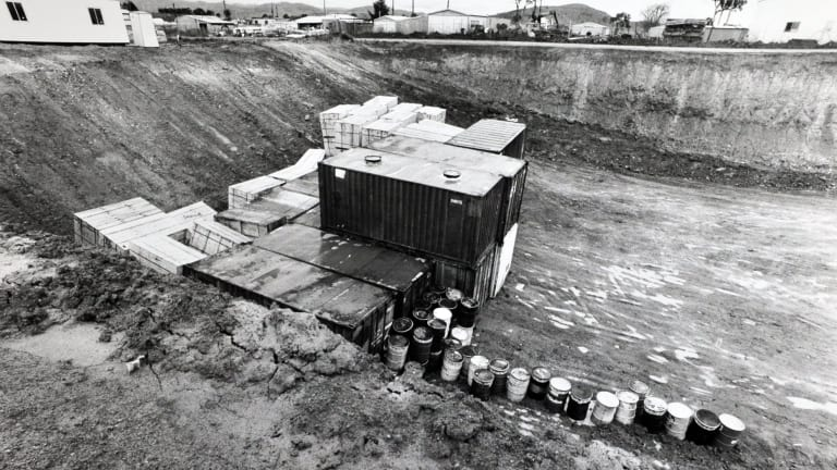 The Fluffy asbestos in shipping containers and drums ready to buried at Belconnen in the early 1990s. An earlier caption incorrectly identfied this picture as the Gungahlin dump.