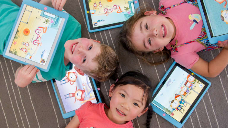 Mawson Preschool students Tommy McCorry, Zoe McDonald and Ella Chew are learning mandarin with the help of a federal government iPad app.