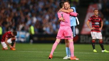 Winning embrace: Vedran Janjetovic and Matt Jurman celebrate Sydney FC's victory over the Wanderers last month.