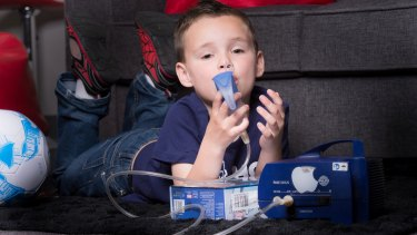 A cystic fibrosis patient uses a nebuliser to clear his airways. People with the disorder have to do this twice a day.