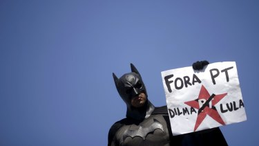 A demonstrator, dressed as Batman, calls for President Dilma Rousseff's  government to be dismissed.