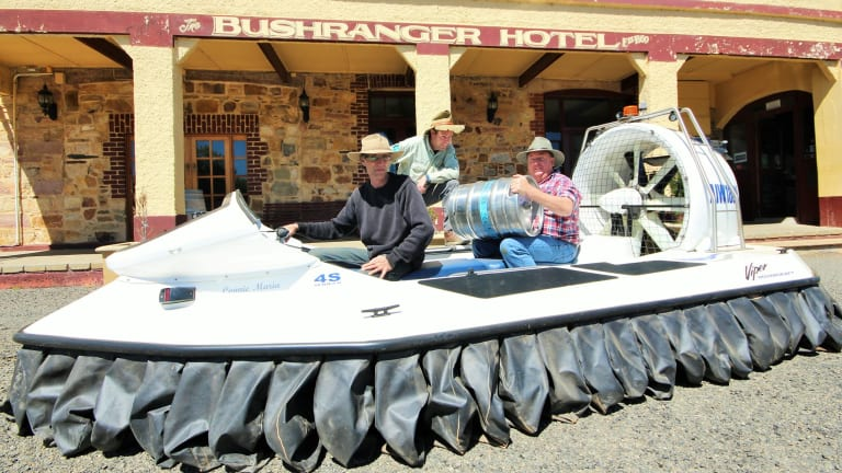 Tim helps Michael Nell and farmer Gary Poile load-up with vital supplies outside the Bushranger Hotel in Collector.