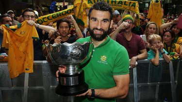 Proud achievement: Socceroos captain Mile Jedinak poses with the Asian Cup during celebrations at Westfield Sydney on Sunday.