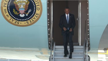 No roll-up staircase available: US president Barack Obama exits Air Force One from its own hatch, at the Hangzhou Xiaoshan International Airport.