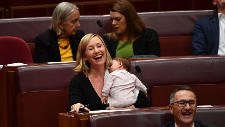 Greens co-deputy leader Larissa Waters soothes baby Alia Joy after breastfeeding her in the Senate.