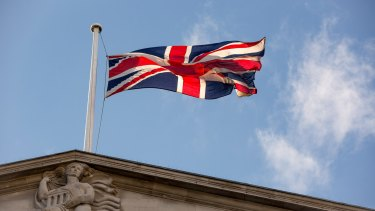 A British Union Flag, also known as a Union Jack, flies above the Bank of England.
