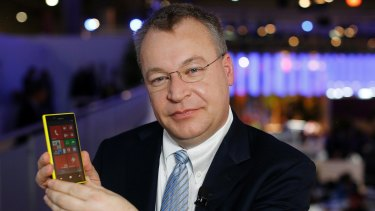 Nokia Chief Executive Stephen Elop presents up a new phone.