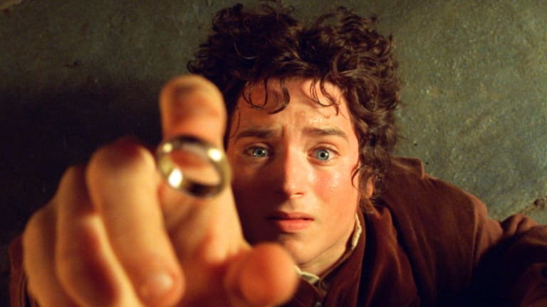 "Elijah Wood's character Frodo reaches for the ""One Ring"", in the film the Fellowship of the Ring."