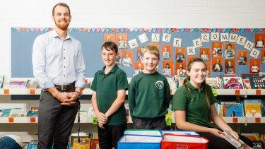 Charnwood-Dunlop School deputy principal Robert Lans with sixth graders Tyreece Ryan (11), Cameron Morton (10), and Trista Buckley (11).