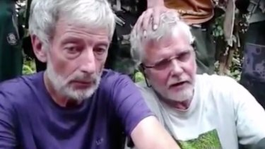 Canadians Robert Hall, left, and John Ridsdel, right, were beheaded by Abu Sayyaf in June.