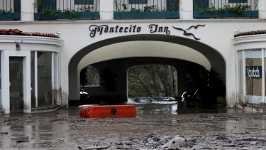 Debris and mud cover the entrance of the Montecito Inn after heavy rain brought flash flooding and mudslides to the area on Tuesday.