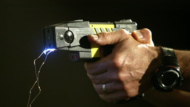 A Perth Law School professor and his partner who were tasered by police have won a damages claim.