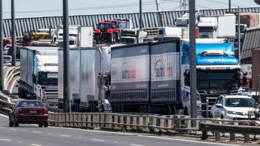 Heavy truck traffic on the West Gate Bridge.