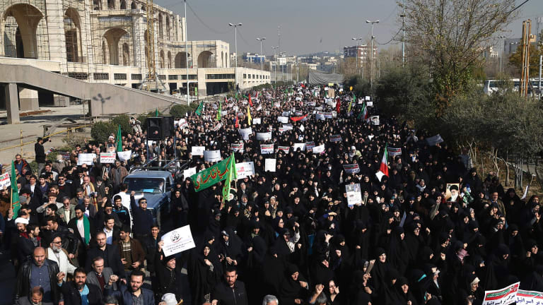 Iranian protesters chant slogans at a rally in Tehran, Iran, on Saturday.