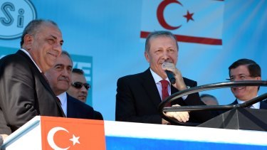 Turkish President Recep Tayyip Erdogan, centre, speaks at the water pipeline ceremony flanked by Turkish Cypriot leader Mustafa Akinci, second left, and Turkish Prime Minister Ahmet Davutoglu, right.