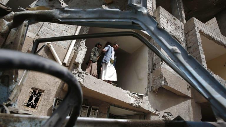 Yemenis inspect a house damaged by a Saudi air strike in the rebel-held capital Sanaa.