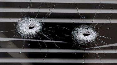 Bullet holes next to the La Belle Equipe cafe in Paris.