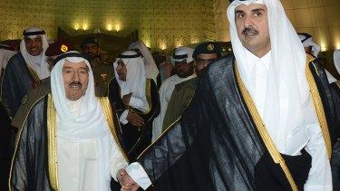 Qatar's ruler Sheikh Tamim bin Hamad al-Thani, right, with Kuwaiti leader  Sheikh Sabah al-Ahmad al-Sabah, who is mediating between Qatar and its accusers.