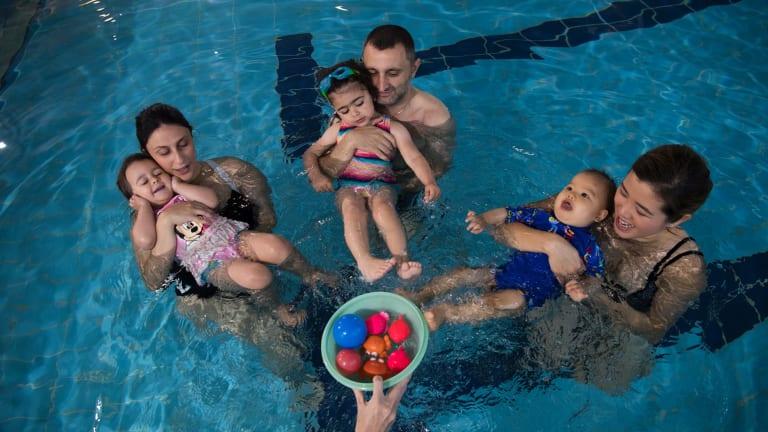 Emilia Garofolo, 2, and mum Amanda; Elsie Kassis with dad Nagib, and Mason, nine months, with mum Jannine Lam were among those at swimming lessons.