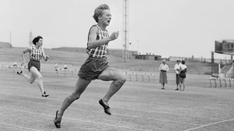 Betty Cuthbert in action during a meeting at the Sydney Sportsground in 1957.