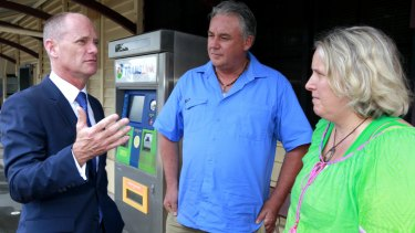 Premier Campbell Newman speaks with locals at Landsborough station.