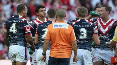 Regretful: Latrell Mitchell looks dejected after a Dragons try.