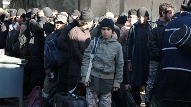 An Islamic State propaganda site shows a boy waiting with other youths to join training camps in Deir al-Zor, in eastern Syria.