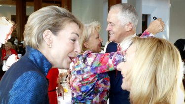 Prime Minister Malcolm Turnbull greets Australia's Ambassador for Women and Girls Sharman Stone during the International Women's Day breakfast in February.