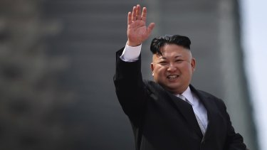 North Korean leader Kim Jong-un waves during a military parade in Pyongyang, North Korea earlier this year. China fears his antics may drive a rise in desertions.