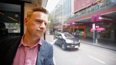 Richard de Cani rides a city tram.
