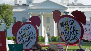 Protesters gather outside the White House in Washington on Thursday.