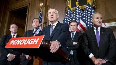 From left: Senators Richard Durbin, Richard Blumenthal,  Chris Murphy, and Charles Schumer listen to Minority Leader Harry Reid (centre) on Monday.